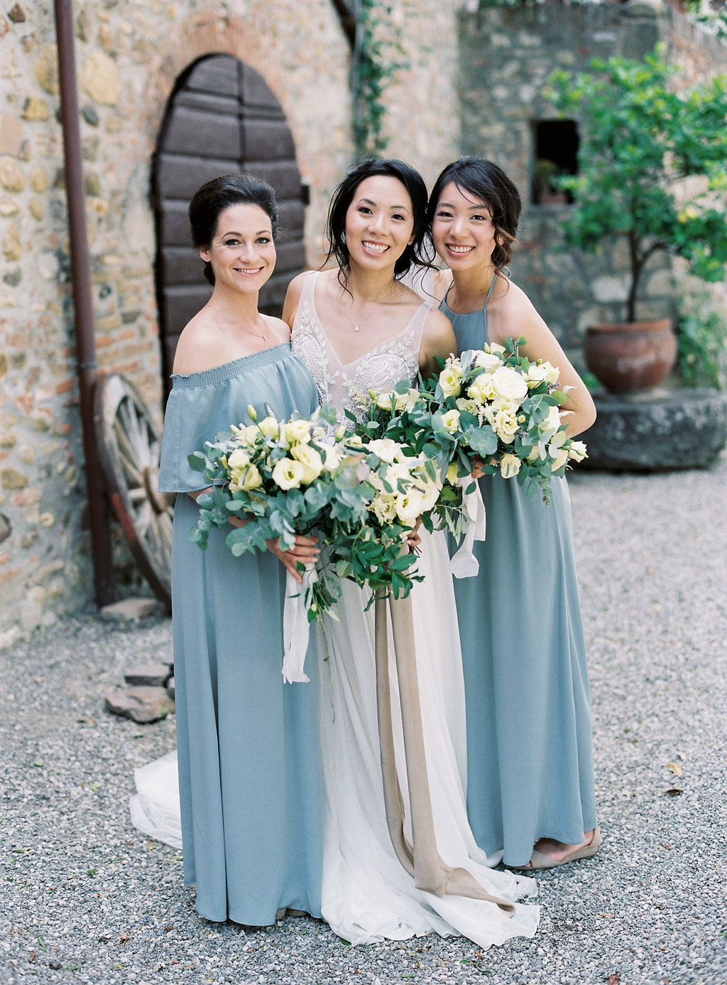 bridesmaids in dusty blue gowns - photo by Katie Grant Photography http://ruffledblog.com/classically-beautiful-intimate-wedding-in-tuscany