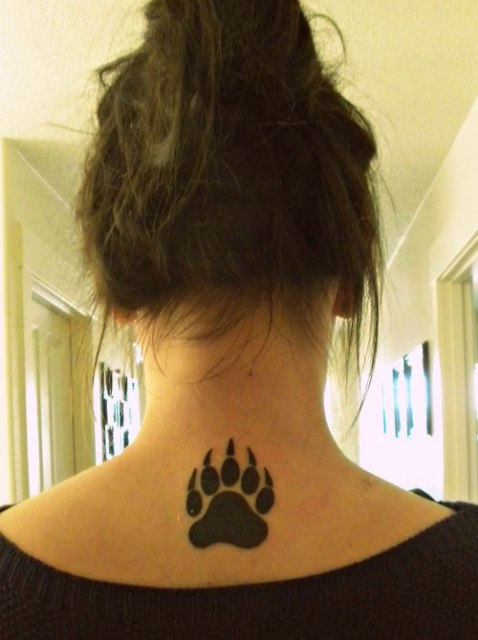 Bear paw tattoo on the neck
