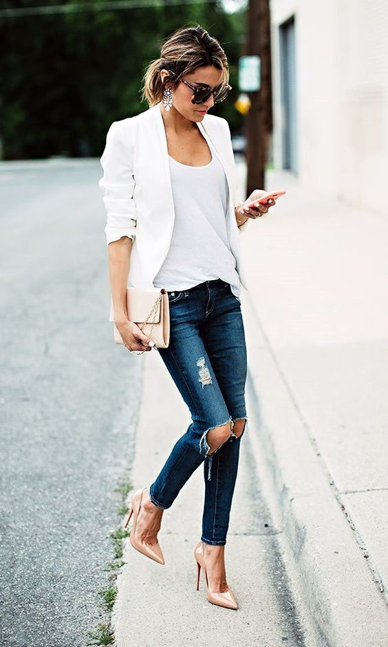 a white blazer, a white top, distressed navy jeans and nude heels for a casual comfy look