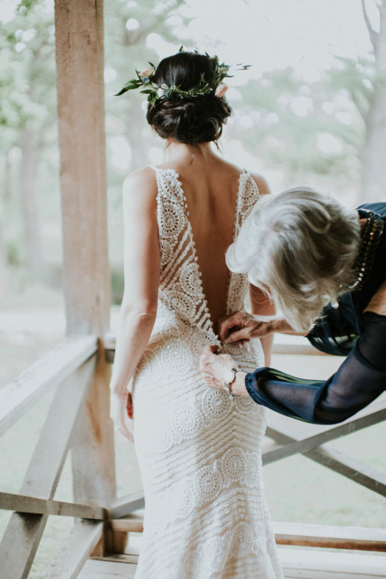 The bride was wearing a gorgeous Maggie Sottero wedding dress of boho lace, with spaghetti straps and a button row on the back