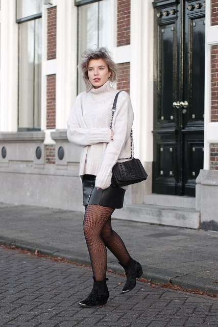 With white sweater, leather skirt and chain strap bag
