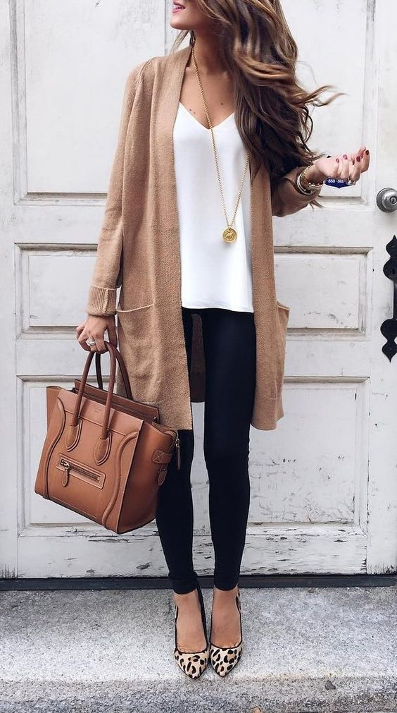 black leggings, a white top, a camel long cardigan, leopard print shoes and a camel bag