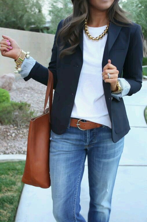 blue jeans, a white top, a black blazer and a statement necklace to work