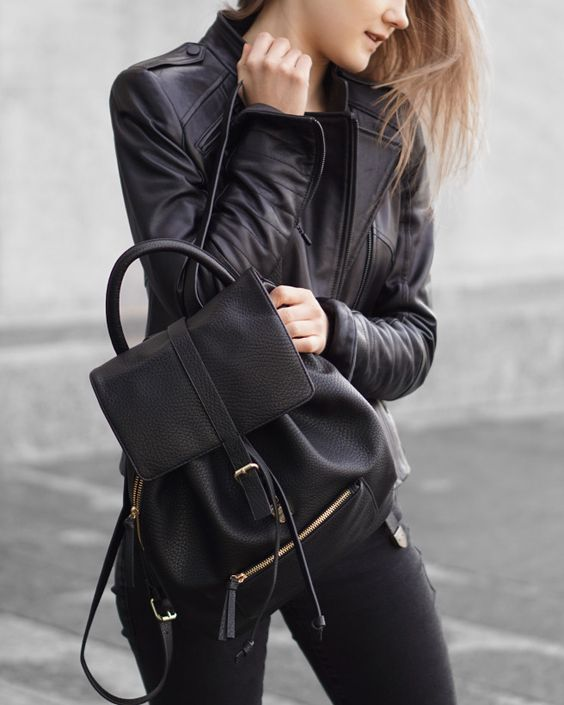 black jeans, a black tee, a black leather jacket and backpack for a rock-inspired look