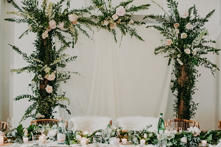 sweetheart table arches - photo by Scarlet ONeill http://ruffledblog.com/industrial-space-meets-enchanted-forest-wedding