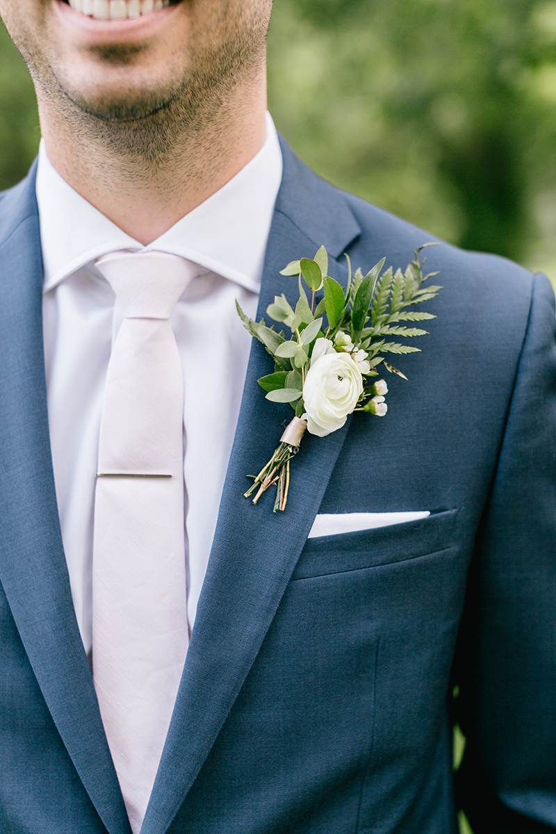 simple summer boutonnieres - photo by Emily Wren Photography http://ruffledblog.com/bright-beautiful-summer-wedding-with-geometric-accents