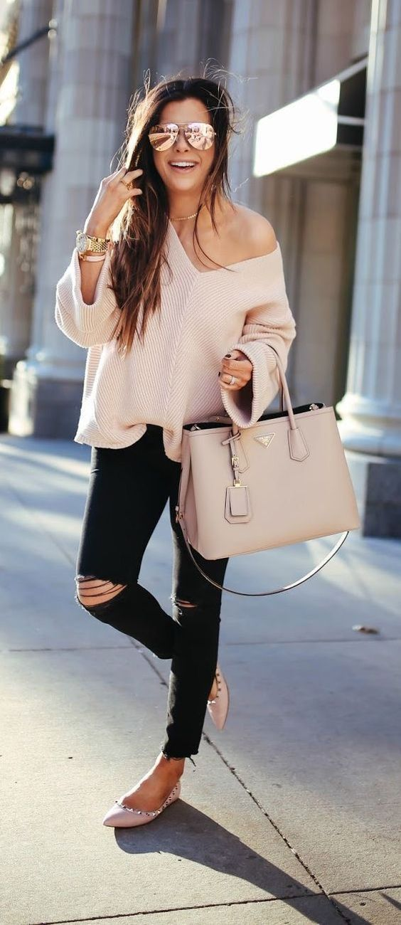 black ripped skinnies, a blush off the shoulder baggy sweater, a blush bag and spiked flats