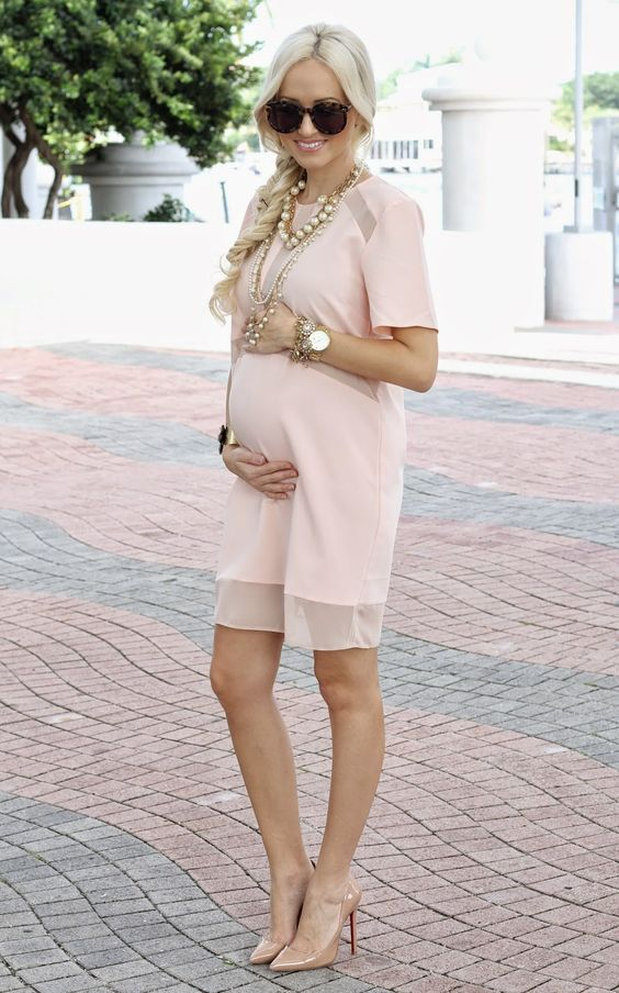 a blush knee dress, nude heels and layered necklaces