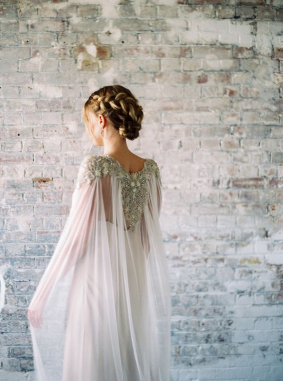 a chic flowy sheer wedding cape with heavy embellishments for a statement look