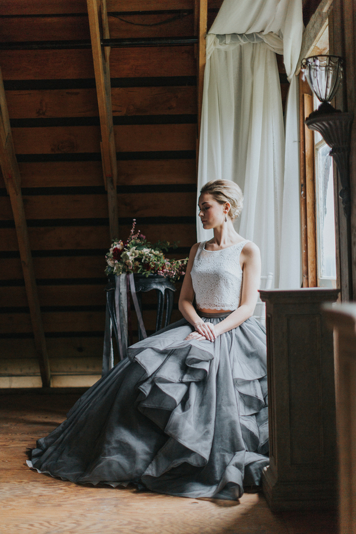 The bride was rocking a chic modern separate with a white lace crop top and a grey layered skirt