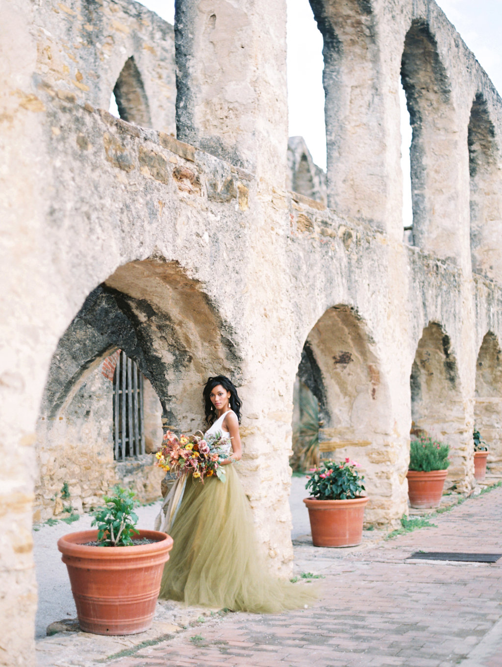 green gold wedding dresses - photo by Charla Storey http://ruffledblog.com/architectural-san-antonio-mission-wedding-inspiration
