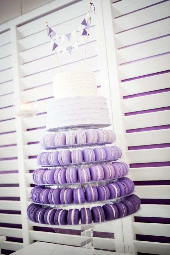 purple ombre macaron tower with a white two-tier wedding cake