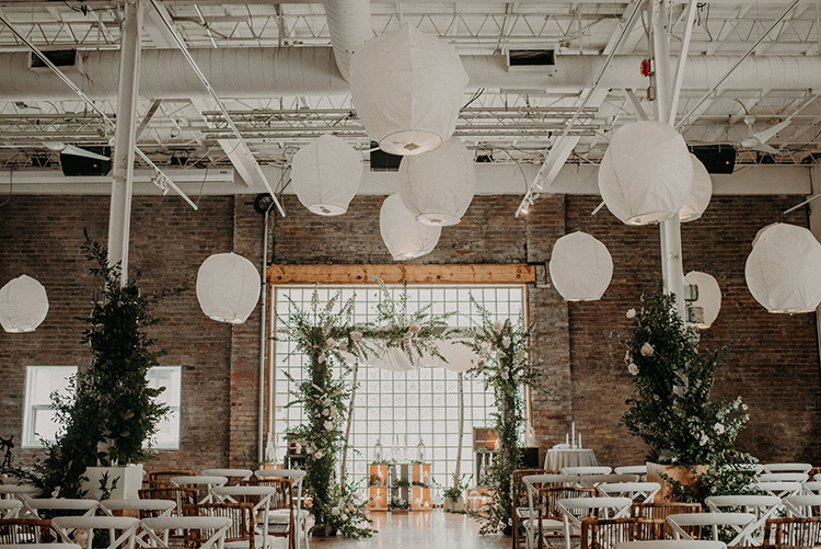 whimsical modern wedding ceremonies - photo by Scarlet ONeill http://ruffledblog.com/industrial-space-meets-enchanted-forest-wedding