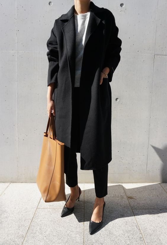 a work look with cropped black pants, a white top, black heels and a black coat