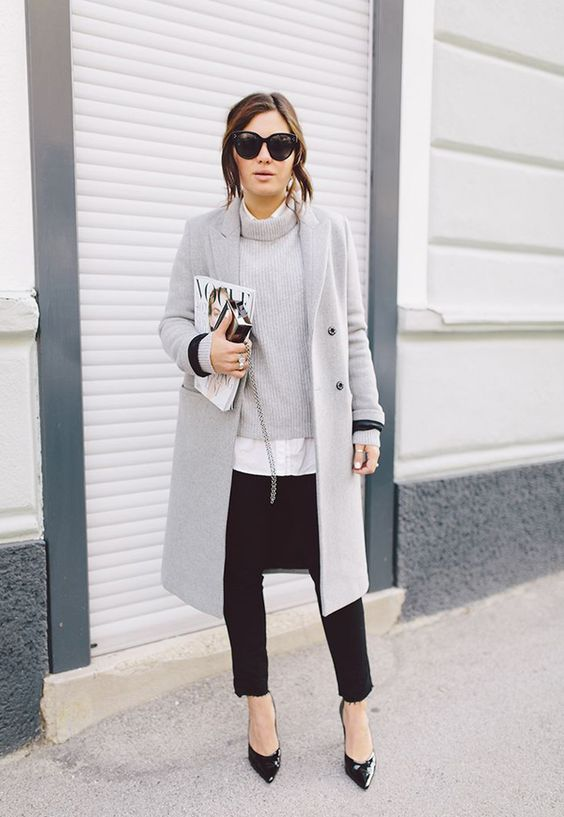 black skinnies, a grey sweater, a white shirt, a grey coat and black heels