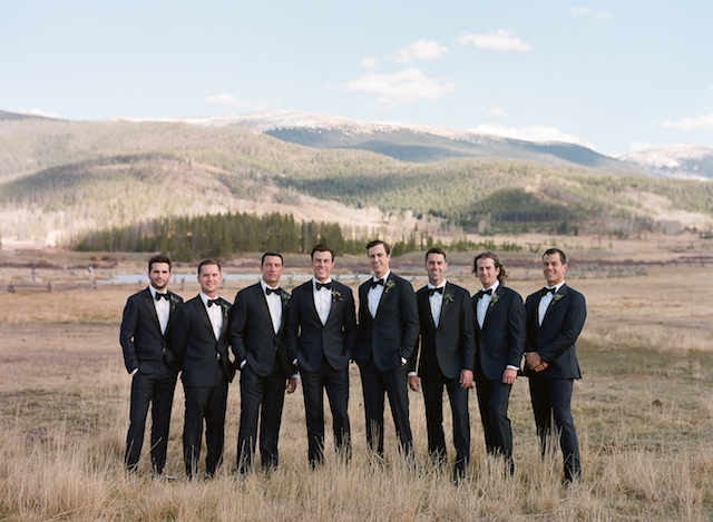 The groom and groomsmen were rocking classic black tuxedos