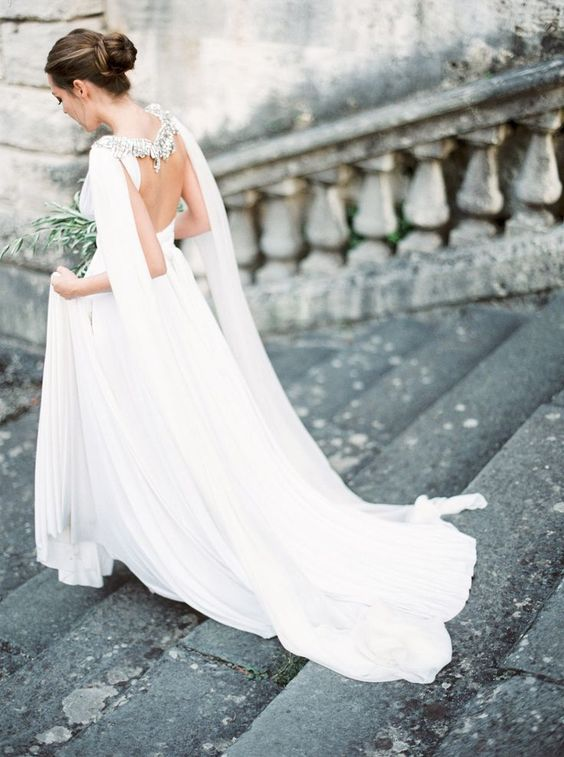 elegant open back wedding gown with an embellished cape to make it stand out