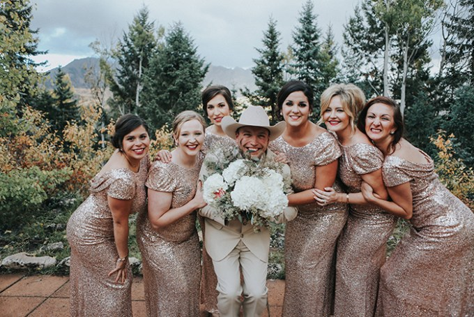 The bridesmaids were wearing rose gold sequin maxi gowns with cap sleeves and hair updos