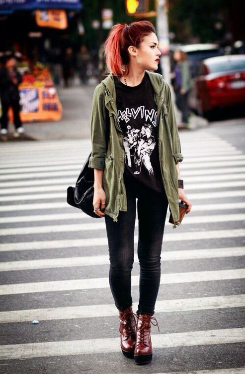 black jeans, a printed tee, an olive green jacket and red platform boots