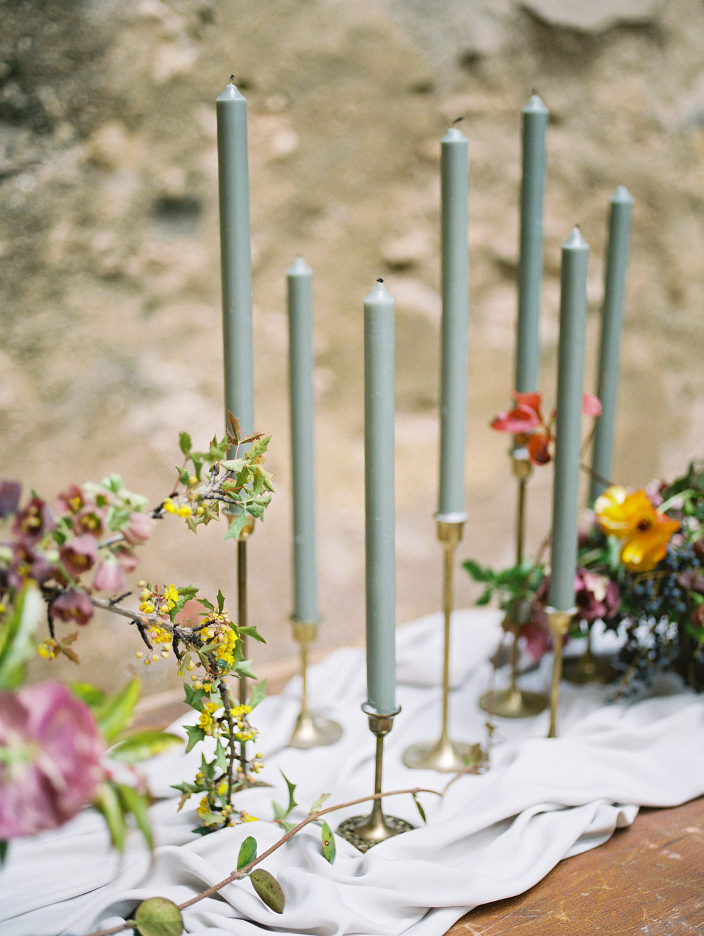 centerpieces with candlesticks - photo by Charla Storey http://ruffledblog.com/architectural-san-antonio-mission-wedding-inspiration