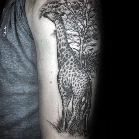 Half-sleeve giraffe and tree tattoo