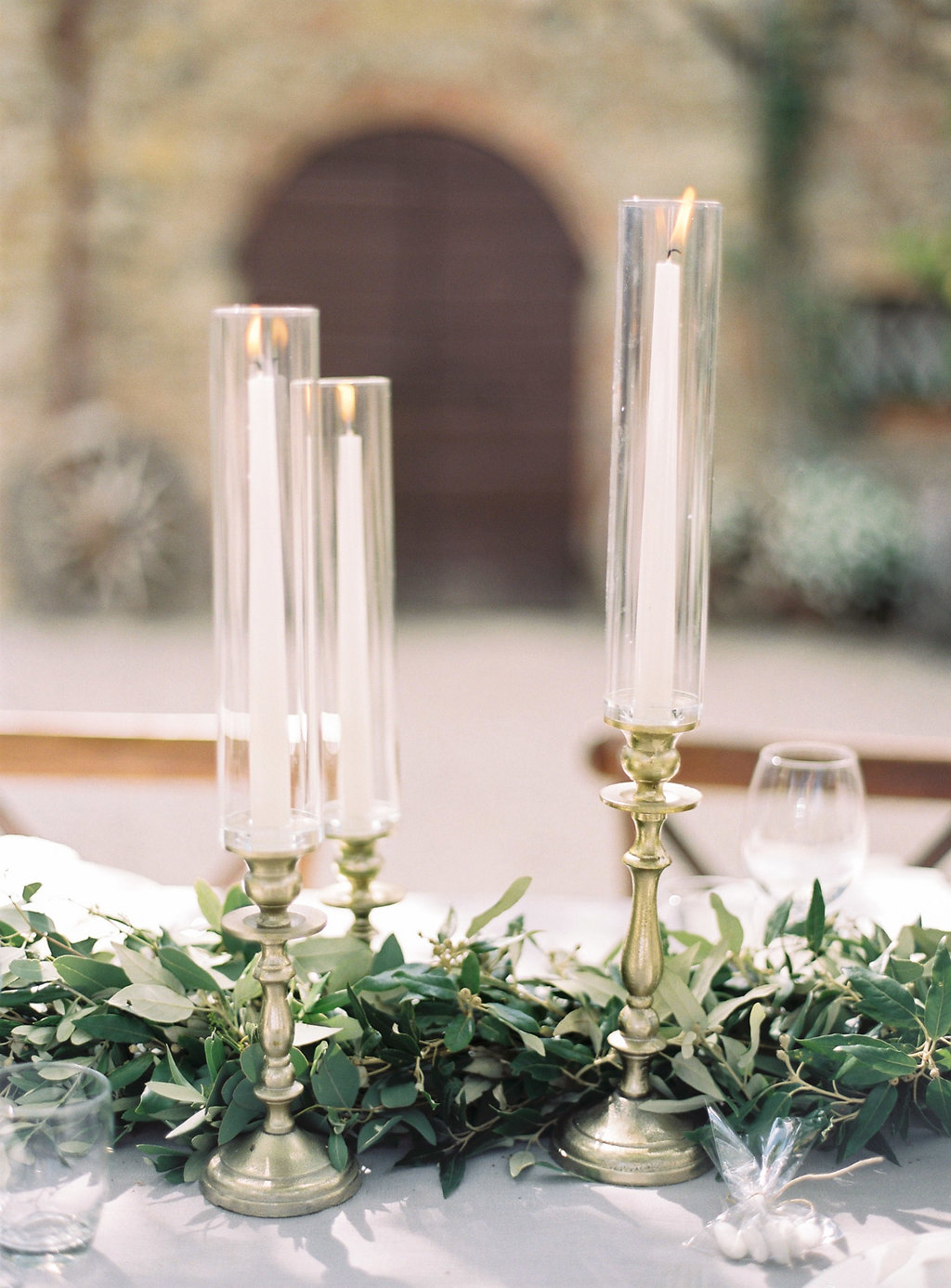 candlestick centerpieces - photo by Katie Grant Photography http://ruffledblog.com/classically-beautiful-intimate-wedding-in-tuscany