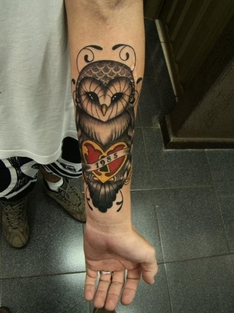 Owl tattoo with red heart and important date