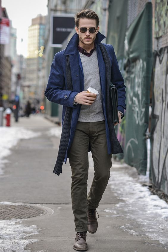 a blue coat, olive green pants, a grey sweater for a chic layered look