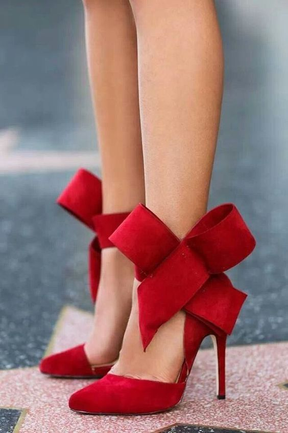 red suede heels with oversized bows on the ankles