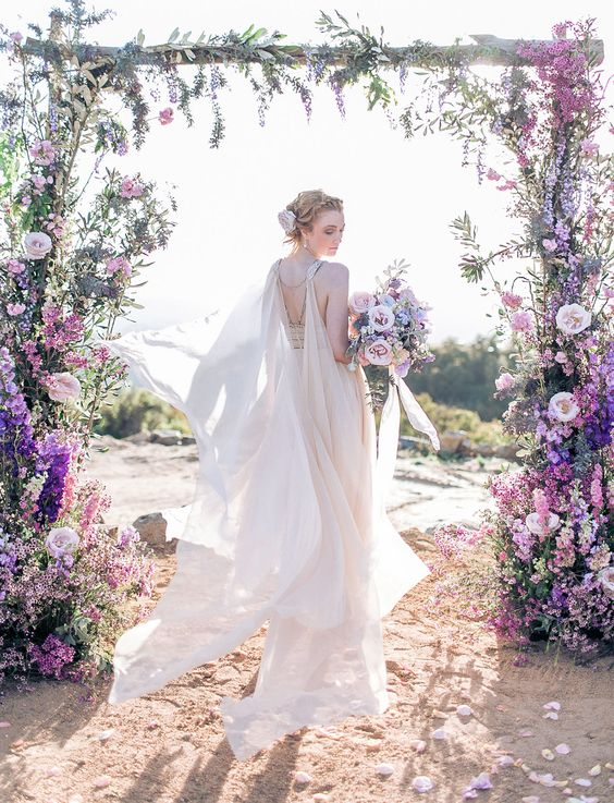 ethereal blush cape attached to the back and shoulders of the dress