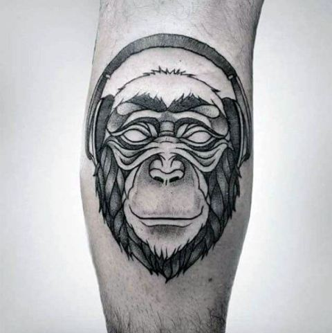 Monkey with headphones tattoo on the leg