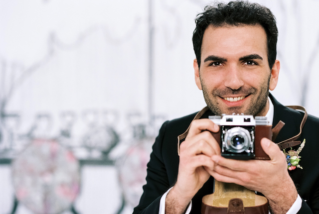 Groom with camera
