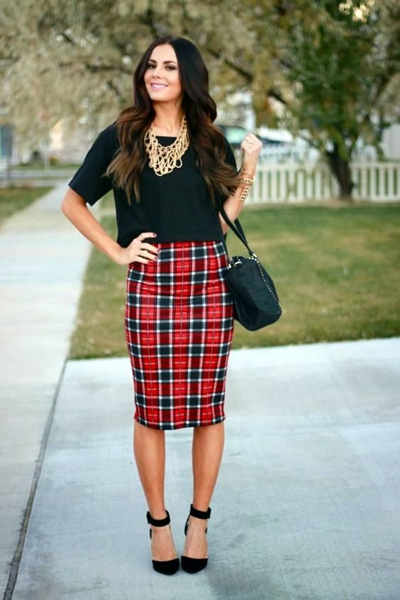 a black crop top, a plaid knee pencil skirt, black suede ankle shoes and a bag