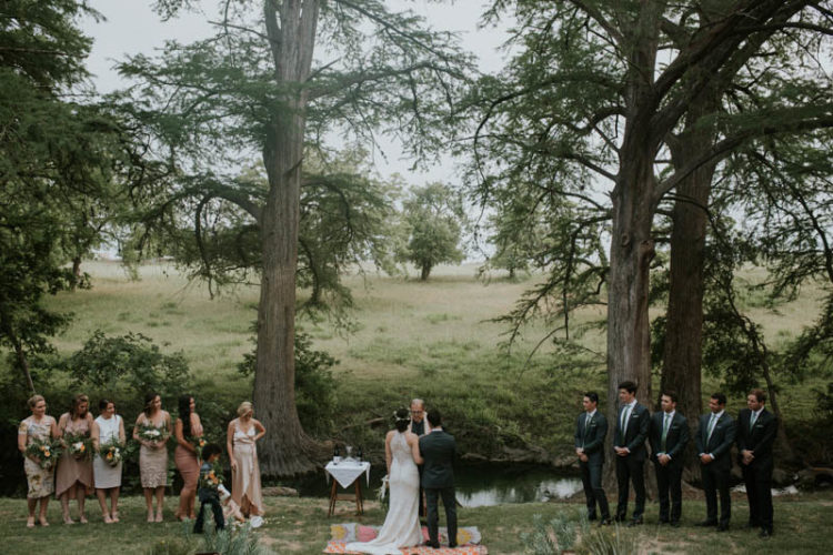 The wedding ceremony took place at the creek, in a beautiful place