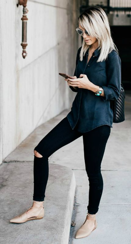 a black chambray shirt, black ripped jeans, nude lace up flats and a black backpack