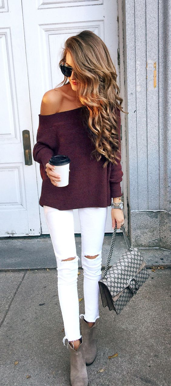 white ripped jeans, a burgundy off the shoulder sweater and grey suede booties