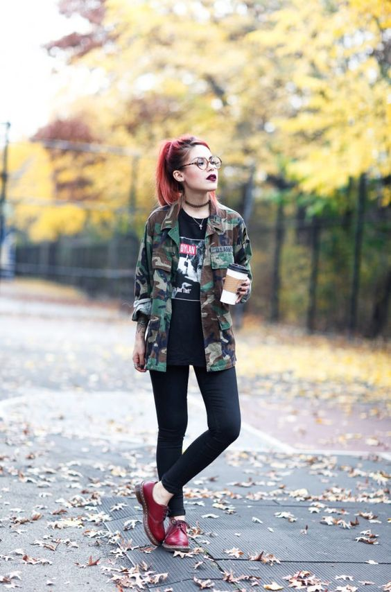 black skinnies, a printed tee, an army-style jacket and red shoes