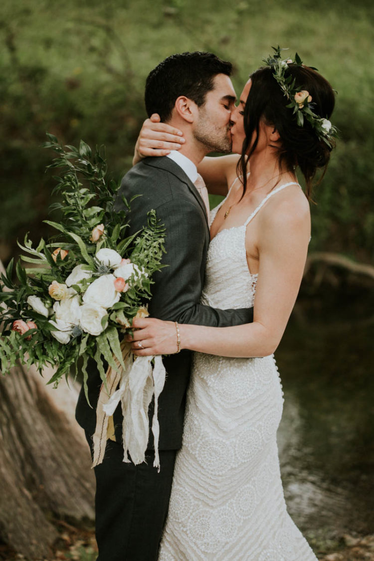 The wedding bouquet was a neutral creamy one with greenery and thistles