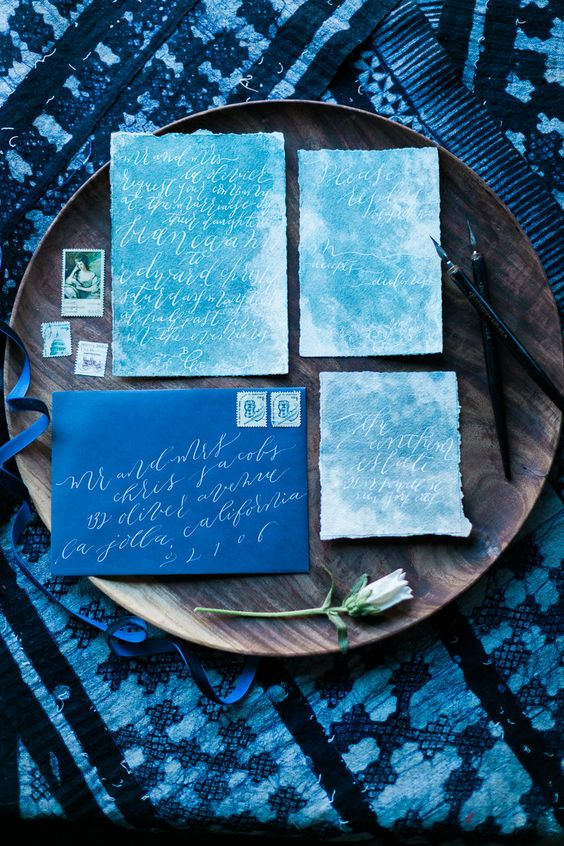 turquoise wedding invitations with white calligraphy and indigo envelopes