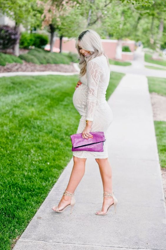 a white lace knee dress with long sleeves, nude heels, a hot pink clutch