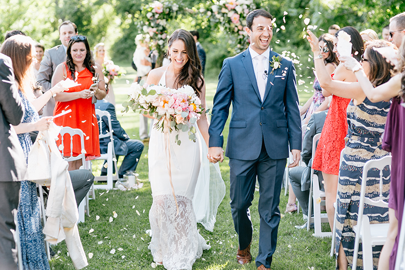 ceremony recessionals - photo by Emily Wren Photography http://ruffledblog.com/bright-beautiful-summer-wedding-with-geometric-accents