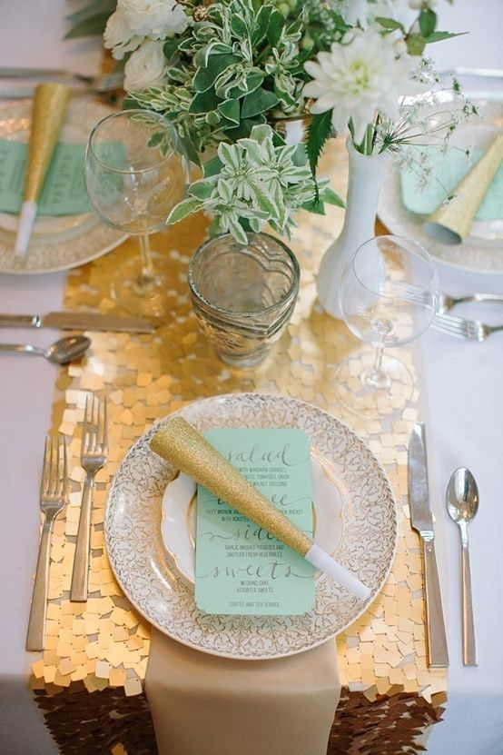 a gold sequin table runner for a mint and gold New Year's Ever table setting