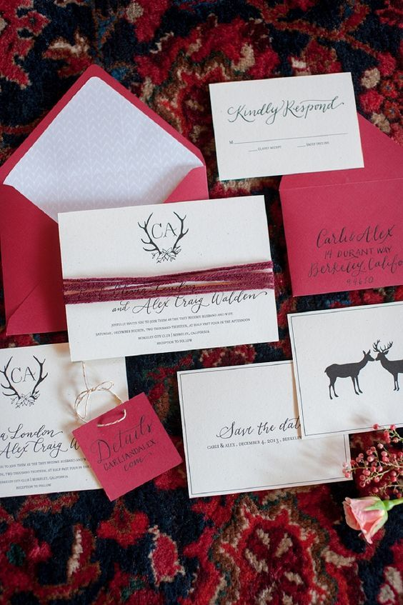 a fuchsia wedding invitation suite with deer mixing traditional prints and bold colors