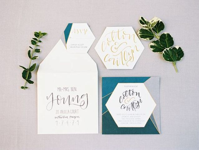 a modern wedding invitation set with geo shapes and lines and crazy calligraphy