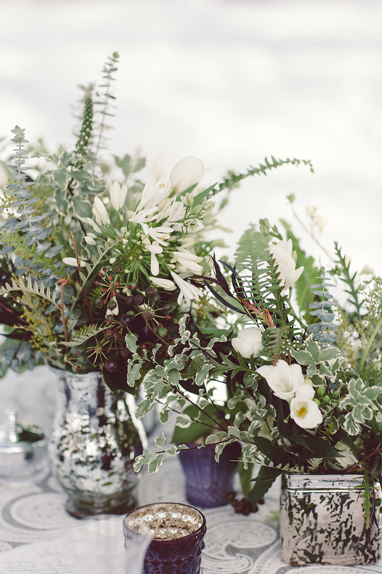 greenery centerpieces - photo by Lilly Red Creative http://ruffledblog.com/lake-tahoe-beach-wedding-inspiration