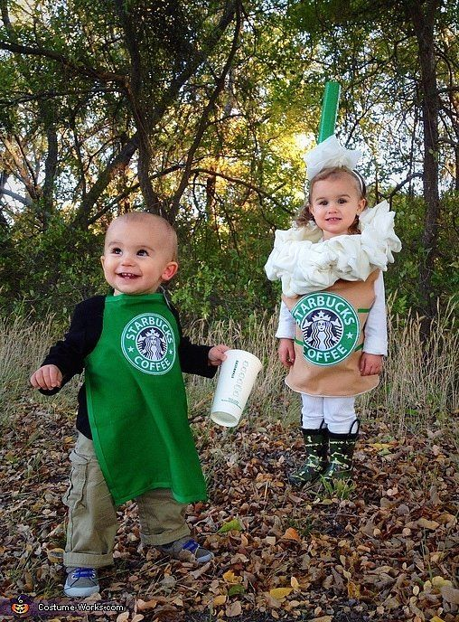 a children's duo in Starbucks costumes - a barista and a frappuccino