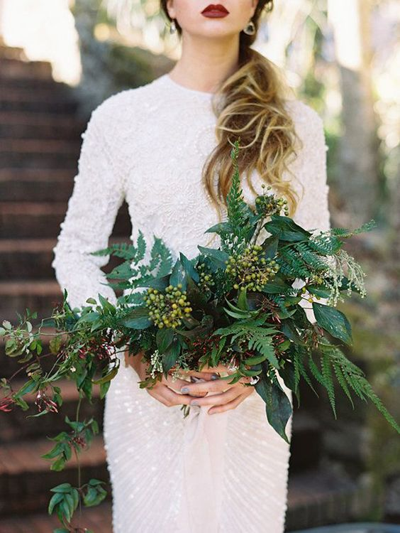 lush textural greenery wedding bouquet of various kinds of foliage, berries
