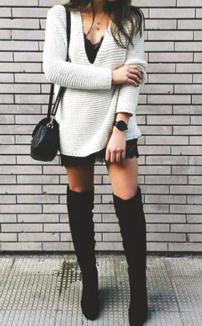 a white deep V-neck sweater over a black lace dress, tall black suede boots and a black crossbody