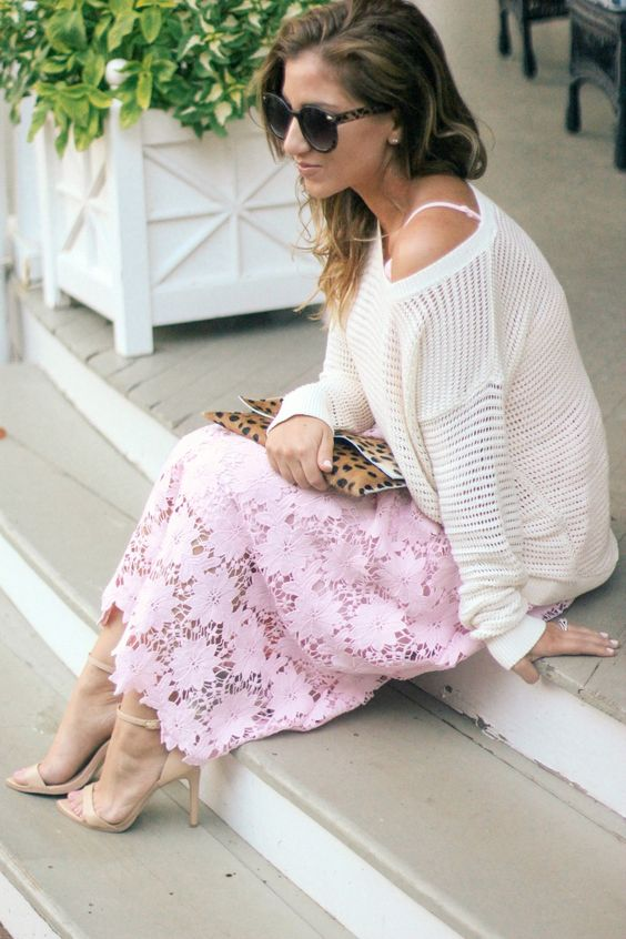 a white sweater, a pink lace midi dress, neutral heels and a leopard clutch