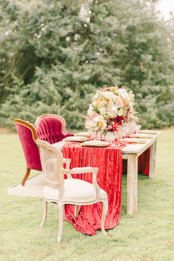 a luxurious red velvet wedding table runner for a sophisticated wedding tablescape